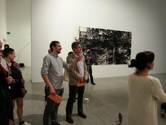 Deputy Minister Joxean Muñoz listens as Peio Agirre, the curator, explains at the First Thought Best exhibition