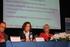 Cristina Uriarte durante un momento de la conferencia, junto a los responsables de las agencias francesa e italiana del programa Erasmus