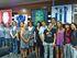 María Silvestre y Blanca Urgell y jugadoras posan junto con la exposición de materia deportivo